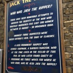Who was 'Jack the Ripper?' board in Whitechapel High Street in the East End of London