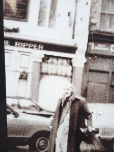 A figure from the past.  The building in the background features part of a name '..E RIPPER'