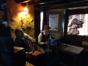 Ian Parson reading a passage from his novel, 'The East End Beckons' - regarding Cornish smugglers in the Blue Peter pub, Polperro, Cornwall. The pub still stands, the smugglers have all gone.