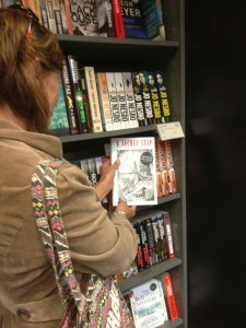 Copies signed by the author on the shelves of Waterstones bookshop.