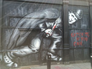Jack the Ripper, one of East London's most infamous criminals depicted on the wall of the same streets he once stalked.